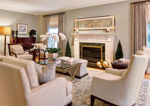 In the living room, a Kravet sofa and armchairs join Lee Jofa lounge chairs around a Barbara Barry coffee table for Baker, from Parker Furniture.
