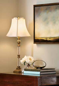A Currey & Company lamp lights a Victoria Adams painting from Murdoch Collections.